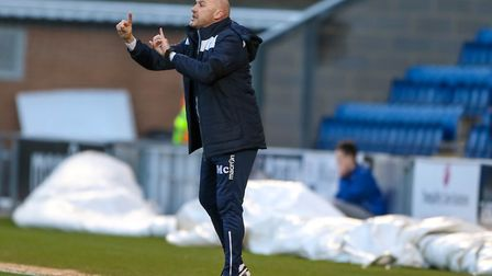 Colchester United boss John McGreal gives his team instructions from the touchline during the U's la