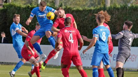 Leiston's Joe Jefford heads the ball down for Leiston, where he has now played more than 400 games.