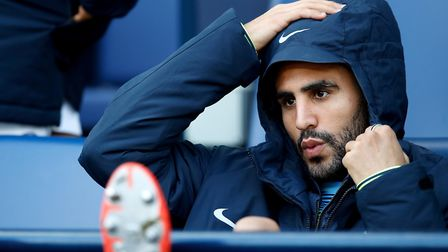 Manchester City's Riyad Mahrez on the substitute's bench for Manchester City. Photo; PA