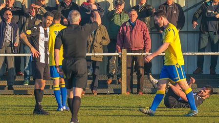 Woodbridge fan clap Ben Jones of Norwich off the pitch as he is one of two players to see red for th