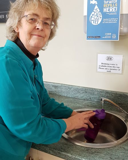 Kerry-Ann in the cafe refilling people's water bottles for free Picture: RACHEL EDGE