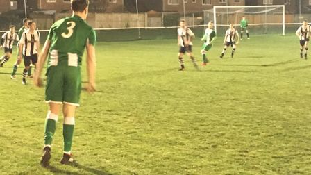 Whitton United's Harry Wales launches a long throw during the Thurlow Nunn Premier clash against hos