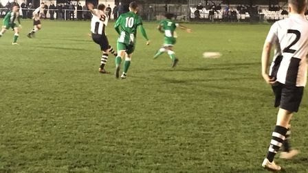 Long Melford's Jacob Brown drills the ball forward during the first half against Whitton United at S