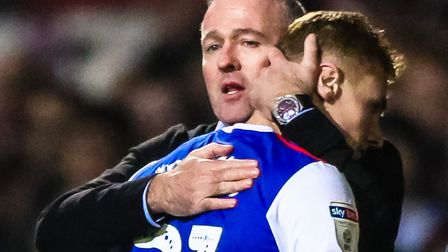 Ipswich Town manager Paul Lambert embraces Flynn Downes as he comes off the pitch to be replaced by