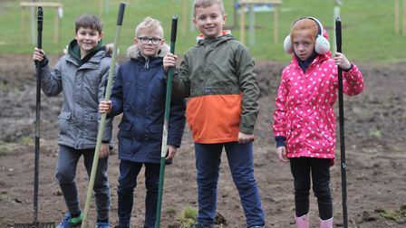 Jack, Callum, Noah and Jessica spent the morning raking the field Picture: SARAH LUCY BROWN