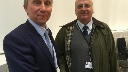 Babergh council leader John Ward (left) with his opposite number from Mid Suffolk, Nick Gowrley said