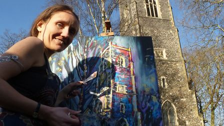 Ipswich artist Lois Cordelia with her first painting of St Clement's Church for the Ipswich Arts Cen