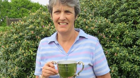 Vicki Hunt, the Ipswich Ladies' captain, with the Suffolk Senior Trophy which she won last year at W