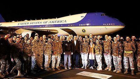 Staff from Air Force One with US Air Force ground crew while the plane was refuelled at RAF Mildenha