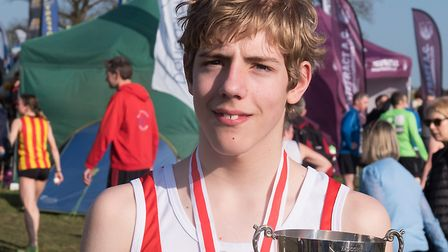 Ben Peck, with his trophy and medal, after winning the under-13 boys' title at the English National