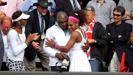 USA's Serena Williams celebrates with father Richard in the players box after beating Poland's Agnie