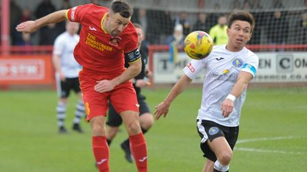 Needham's Gareth Heath, left, heading the ball on against King's Lynn, is expected to return to the