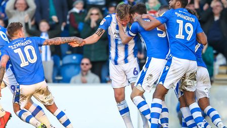 Frankie Kent is congratulated by team-mates after scoring the equaliser for the U's in the 1-1 draw