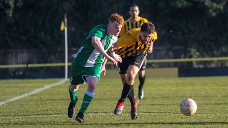 Stowmarket Town's Jack Baker, right, battles Whitton's Jacob Lay for the ball Photo: HANNAH PARNELL