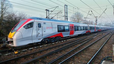 The first 12-car Intercity-style train travels through Ipswich on its way from the Channel Tunnel to