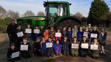 Great Barton CE Primary Academy with the tractor that visited the school Picture: KATE PIZZEY