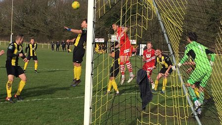 Another corner is propelled into the Basildon box, where Paul Hayes (red shirt) prepares to challeng