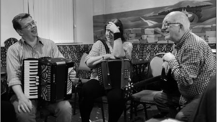 Michael Sheehy, Katie Howson & John Howson take a break during a music session at the Willie Clancy