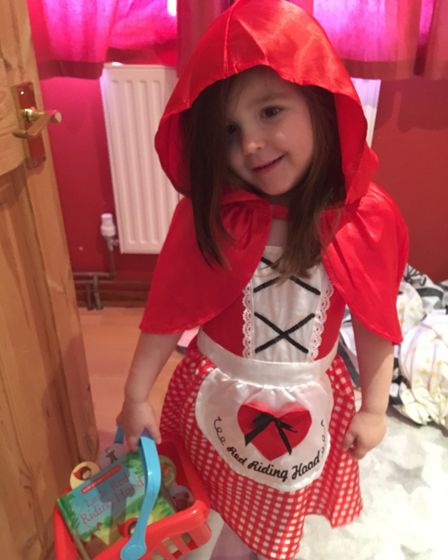 Rosie Ward, age four, from Ipswich heading out to play as Little Red Riding Hood. Picture: SUZANNE D