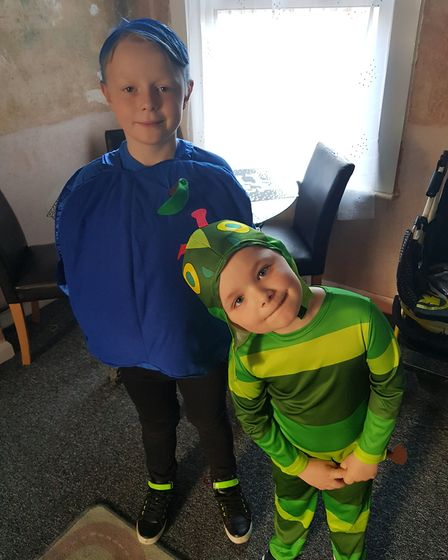 Faigan age five is dressed as the very hungry caterpillar and Devon age nine is the blueberry that t