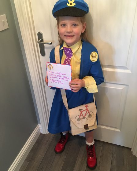 Lilly May from Stanton Community Primary School went as The Jolly Postman - and her parents helped c