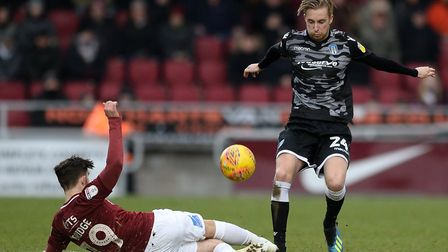 Ben Stevenson battles with Jack Bridge during the U's 4-0 win at Northampton Town, early last month.