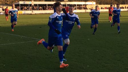 Cemal Ramadan celebrates after converting a third minute penalty during Bury Town's 3-2 home defeat