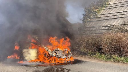 The car is completely taken over by fire in Dedham Road, Stratford St Mary Picture: ROBERT BIRNIE