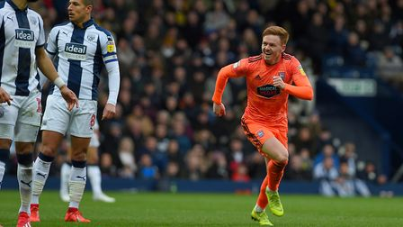 Jon Nolan celebrates his headed equaliser at West Brom during the second half Picture Pagepix