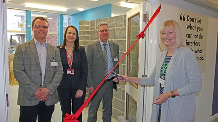 Cutting the ribbon. Left to right: Matthew Jolly, Phelan Construction; Alison Andreas, Principal and