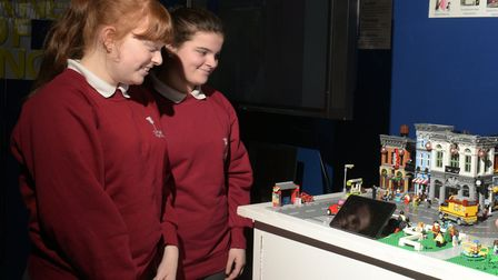 Ellie and Shannon taking a look at a model that demonstrates how a smart city can work Picture: SAR