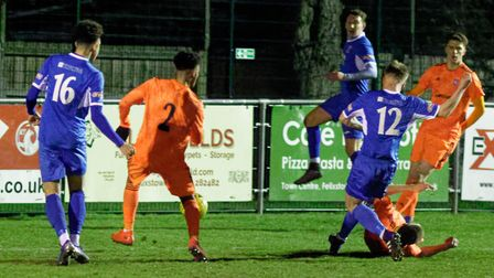 Leiston substitute Harrison Bacon (No.12) fires home his side's 92nd minute winner in the Suffolk Pr