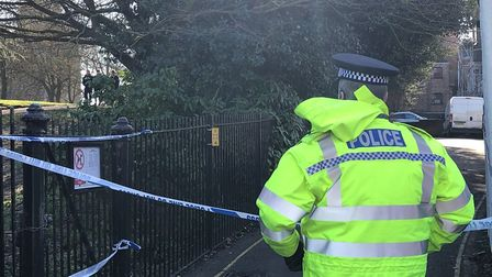 Officers stood guard at public entrances to Ryegate Road after a man was found dead Picture: JAKE FO