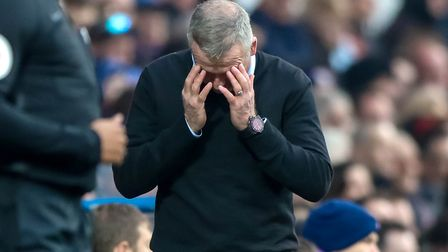Town manager Paul Lambert reacts after seeing his side conceded a sloppy goal late in the first half