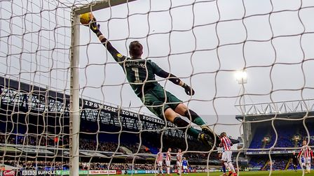 Alan Judge watches as his free-kick brushes the finger tips of Stoke keeper Scott Carson, before rat