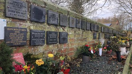 The plaques for those whoase ashes are buried at St Mary the Virgin Church in Lawford, Essex Picture