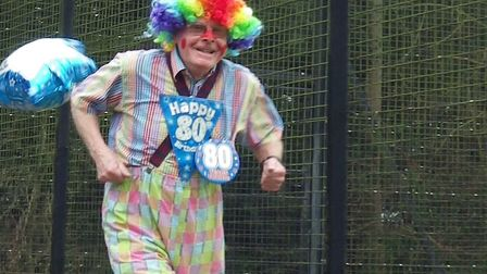 Martin Tilley, in colourful attire, running the Bury St Edmunds parkrun on the weekend of his 80th b