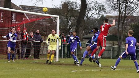Miles Powell climbs above Tilbury's Abdul Salami to equalise for the Seasiders. Picture: STAN BASTON