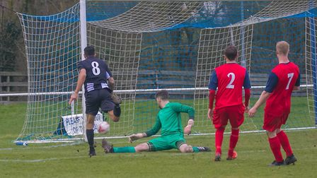 Carlos Edwards scores one of his two goals for Woodbridge Town in their big win over Hadleigh United