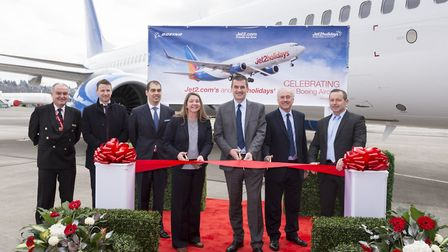CEO of Jet2.com and Jet2holidays Steve Heapy cuts the ribbon at the handing over ceremony at Boeing�