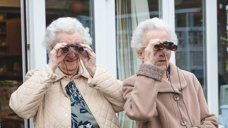Two residents at the Stowmarket care home have been practising with their binoculars. Picture: SIMON