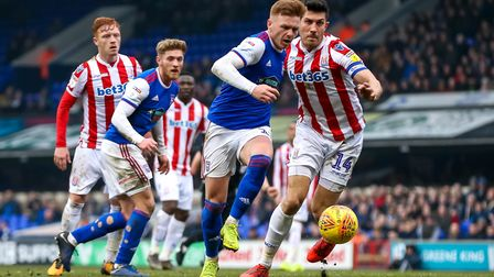 Jon Nolan battles to get away from Stoke's Danny Batth on Saturday. Picture: STEVE WALLER