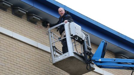 Colchester Sixth Form College maintenance supervisor Andrew Harding instals swift boxes and speakers