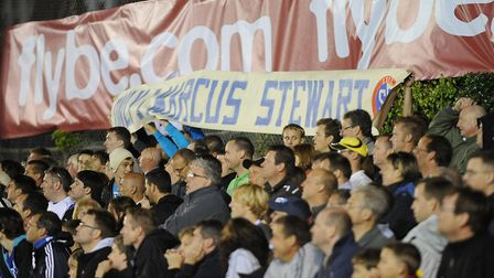 """TRIBUTE: Ipswich Town fans holding up a banner which read """"There's only one Marcus Stewart"""" at Exete"""
