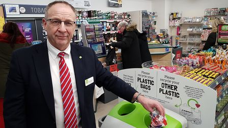 Roger Grosvenor, chief executive of the East of England Co-op with one of the new instore recycling