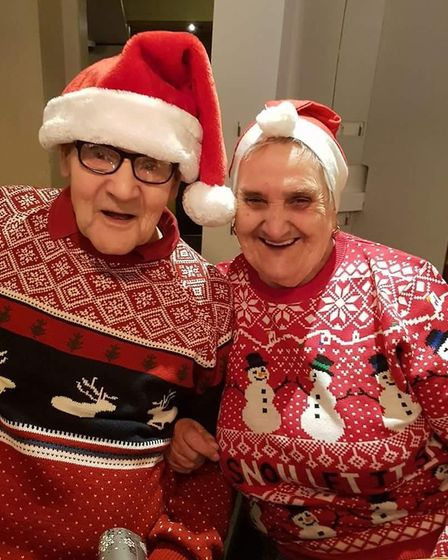 Walter Hatton in his Christmas jumper with his wife Margaret Picture: NADINE BOWLER