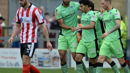 Courtney Senior is congratulated on equalising at Lincoln City during the penultimate weekend of las