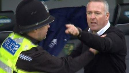 Ipswich Town boss Paul Lambert was sent off just before half-time after a touchline brawl on derby d