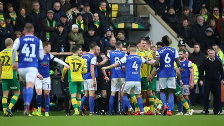 Norwich City's and Ipswich Town's players confront each other before half time leading to Ipswich To