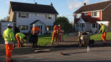 Suffolk Highways workers resurfacing part of the footpaths on the Running Waters estate in Boxford P